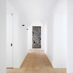 Linen Panel Kim Wilkie's London flat is made up of white walls, oak floors and a sense of tranquility. A linen panel by Nicola Henley hangs at the end of the entrance hall, adding interest to the minimalist space.