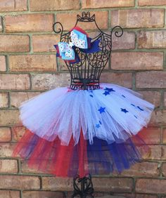 A personal favorite from my Etsy shop https://www.etsy.com/listing/385737592/4th-if-july-inspired-tutu-woth-matching