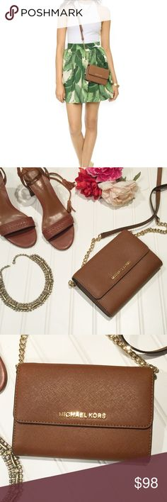 | michael kors | Jet Set Convertible Crossbody Where beauty and functionality collide!  Gorgeous Michael Kors Jet Set Travel Saffiano Leather Smartphone Crossbody   Rich cognac brown | Gold accents/hardware | Removable strap | Credit card slots | Phone slot | Small interior zipper | NWOT   Bought from Macy's but never got around to carrying   *Model photo from web — not attempting to claim as my own   $160 retail   Bundle to save 😍😍😍 Michael Kors Bags Crossbody Bags