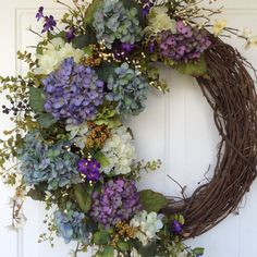 Spring Wreath-Hydrangea Wreath-Spring Wreath for Door-Summer Wreath-Easter Wreath-Provencal Wreath-French Country Wreath-Garden Wreath This wreath is perfect for the person who loves hydrangea wreaths, but prefers something more natural looking. This design features a lovely mix of plum, violet, chartreuse and blue hydrangea blossoms. Purple violets, clusters of berries and flowering vines weave throughout the design. Lots of foliage, including seeded eucalyptus and grape ivy give it a…