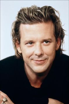 Mickey Rourke.    Now to find a picture of him in The Wrestler.