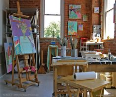 "Margaret Tsirantonakis' art studio in Stamford, Connecticut: ""My studio is a 290 square foot corner space on the second floor of a two floor brick building. My studio is one of 14 studio spaces on the floor that comprises studio members of the Loft Artists Association, a group of artists that have occupied various studios in this previously undeveloped South End of Stamford. I paint in natural light so this corner space is ideal for my working process."""