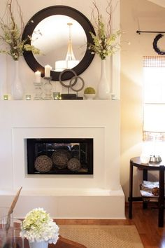 Circular shape nice complement to squareness of mantel. Here they're used effectively in pairs