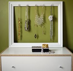 DIY necklace holder tutorial from http://www.thebudgetbabe.com/archives/3593-Supereasy-DIY-Picture-Frame-Necklace-Holder.html#.Tok-z9QcSfU