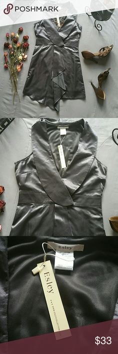 """ESLEY SILVER COLLARED V-NECK DRESS *SALE IS FOR DRESS ONLY!  *BRAND NEW WITH TAGS  *55% COTTON 45% SILK - NO STRETCH  *SET YOURSELF APART WITH THIS COLLARED V-NECK WITH UNIQUE DRAPING FROM THE WAIST DOWN FROM ESLEY *SIDE ZIP AND CLASP CLOSURE *ACROSS THE BUST APPROX 34"""" *ACROSS THE WAIST APPROX 29"""" *SHOULDER TO HEM 34"""" *STORED IN NON-SMOKING PET FREE HOME Esley Dresses"""