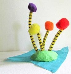 Dr. Seuss trees....preschool and/or Seuss Art - use clay, pipe cleaners and pom poms.