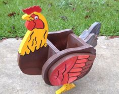 Beautiful Handmade Rooster or Chicken Planters. Rooster is 21 long 18 High 11 Wide. Chicken is slightly smaller. Both hold a 7 pot or screened for potting soil. Nailed and Glued together. Built very well and sturdy. Covered with lacquer for protection. Wooden Planters, Planter Boxes, Landscape Timber Crafts, Animal Cutouts, Wood Craft Patterns, Diy Garden Bed, Wood Shop Projects, Wood Dog, Wooden Animals