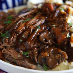 Slow Cooker Beef Pot Roast: a favorite secret family recipe for an extra flavorful tender beef pot roast! You won't believe the ingredient list, but I promise it makes the BEST pot roast! #PotRoast #SlowCooker #Crockpot #SlowCookerPotRoast #CrockpotPotRoast #DinnerRecipes #CrockpotRecipes #SlowCookerRecipes