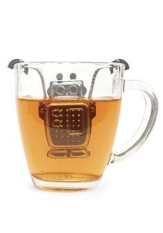 Kikkerland Robot Tea Infuser and Drip Tray. Use this charming robot stainless steel tea infuser to prepare your favorite loose tea. Rest him on the included drip tray when your tea is steeped. Eclectic Kitchen, Kitchen Decor, Kitchen Dining, Drip Tray, Tea Infuser, Tea Strainer, Cool Gadgets, Drinking Tea, Kitchen Gadgets