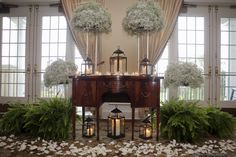 Preppy navy and green wedding at Belmont Country Club from Dogwood Events and Kristen Gardner Photography. Flowers by Rick's Flowers. #wedding #ceremony #altar #lanterns #candles #ferns #green #white #petals #indoor