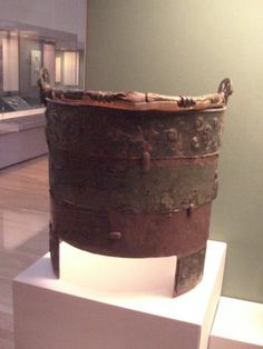 The Aylesford Bucket Burial from Kent, Britain 75-25 BC. This wooden bucket style cauldron wrapped in bronze contained cremated human bones. It was found in a grave with a bronze jug, a pan, as well as three bronze brooches, and four pots.