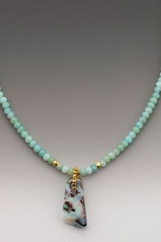 """""""Breeze"""" ~ A trapezoid-shaped Australian two-sided aqua-hued boulder opal on faceted amazonite rondelles with 18K accents."""