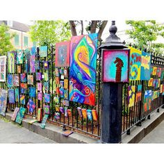 Art at Jackson Square. I have a picture of me when i was 6 on this fence. :)