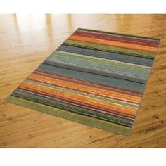 @Overstock.com - Rainbow Multi Stripe Rug Rug (8' x 10') - This gorgeous mix of oranges, yellows, and blues in varied widths is the finishing touch for an updated room you've been looking for. Non-allergenic, stain and fade-resistant materials are soft underfoot and hassle free.  http://www.overstock.com/Home-Garden/Rainbow-Multi-Stripe-Rug-Rug-8-x-10/6589096/product.html?CID=214117 $161.99