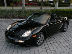 """2005 Porsche Boxster with only 49k Miles for $24,900. Black Exterior, Black Leather Interior, 2.7L H-6, 5-Speed Manual Transmission, Sport Chrono Package (Sport Tuned Engine & Suspension Management), Bose Premium Audio with CD Changer, Heated Seats, Porsche Stability Management, Retractable Rear Spoiler, Power Convertible Top, Cruise Control, Rear Wind Deflector, Automatic Climate Control, Red Brake Calipers, 17"""" Alloy Wheels & Much More. Call Auto Haus of Fort Myers at 239-337-4287"""