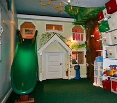 This is one of THE most incredible playrooms I have ever seen. Check out the source for more pictures! The playhouse has two levels - including a kitchen, dress-up closet, stage, grocery store, and more! LOVE IT.