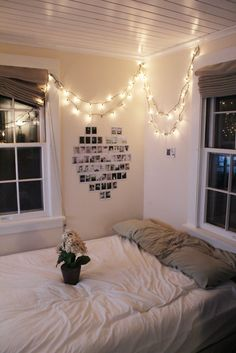Repurposed holiday lights + photos + flowers = a simple, but comfortably decorated room.