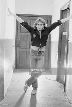 Phil Collen, guitarist with English rock group Girl (and later Def Leppard) posed backstage in Oxford, England in January 1980.