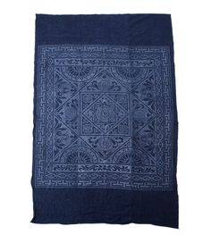"An indigo dyed batik bed cover/throw. Woven from homespun linen by Dong Hill tribes in Hunan province. Originally a bed cover but great for a wall hanging or a headboard DIY project! - 84"" x 48"""