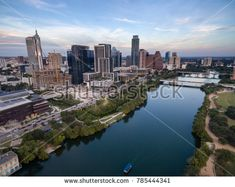 Austin City Skyline Near First Street Bridge Colorado River by Christopher_Boswell. Aerial view of the Colorado River meandering along the Austin Texas waterfront Bisbee Arizona, Arizona Usa, Photo Stock Images, Stock Photos, Texas Photography, Food Photography, Adirondack Park, Colorado River, Aerial View