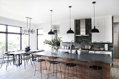 """Open Plan - """"It's hard to pick a favorite room in the home, but if I had to choose it would be the kitchen/dining/living area,"""" shares Winnie. Modern Farmhouse Kitchens, Rustic Kitchen, Black Kitchens, Kitchen Interior, Home Interior Design, Kitchen Dining Living, Küchen Design, Modern House Design, Home And Living"""