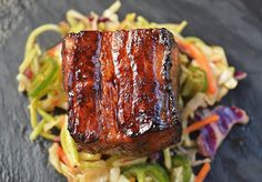 Slow Roasted Pork Belly Bites over Jalapeno Slaw makes for a great appetizer or light entree. The crispy crust combined with the slaw is delicious!