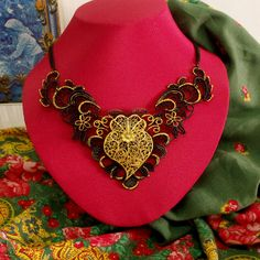 Portugal folk Viana Heart rich gold filigree style Black metal lace necklace. Inspired in Portuguese traditional filigree jewelry used by country women in the north of Portugal. $75.00..#madeinportugal#vianaheart#colarcoraçãodeviana#portuguesefiligree#heartofviananecklace#portuguesejewelry#helenaaleixo#portugalfolk