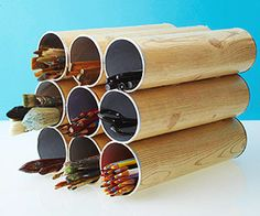 cover pringles cans in scrapbook paper and hot glue together for extra long items such as paintbrushes