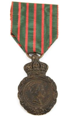 """French Napoleonic Saint Helena Medal with original ribbon. The front of the medal read """"Napoleon I Empereur"""" (The Emperor Napoleon) with Napoleon bust. Reverse reads """"Campagnes de 1792 a 1815, A ses compagnons de glores sa derniere pensee 8th helene 5 mai 1821"""" (The 1792-1815 Campaigns, To his fellow glories his last thoughts 8th Helen May 5, 1821). In 1857 Napoleon Bonaparte honored all still living combatants who fought for France in the period of 1792-1815."""