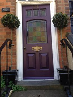 """Our front door painted in """"Pelt"""" by Farrow and Ball"""