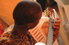 people - music - guitar - musician - play - playing - art - child - kid - boy