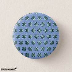 Purple flowers pattern button: the design is a pattern of flowers with purple background. the design was inspired from cool rock bands and pop music culture, the design is on a button pins. #purple #flowers #pattern #roseflower #flower #popmusic #flowerbackground #design #flowerspattern #button #pins #buttonpins