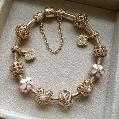 GOLD PANDORA CHARM BRACELET- In the future you can get me a new charm for every occasion (birthday, xmas, valentines, etc)