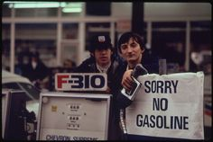 """Gas Station Attendants Peer Over Their 'Out of Gas' Sign in Portland, on the Day Before the State's Requested Saturday Closure of Gasoline Stations 11/1973"" Photo by David Falconer"