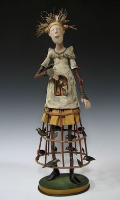 I love these whimsical dolls/figurines.  They speak to the soul.   Akirastudios.com