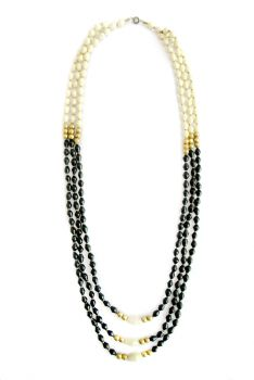 Josephine - ONETRIBE is a line that includes hand rolled beads made from locally found paper.  A common Ugandan tradition, many women have chosen beading not only as a way of supporting their families, but as a fundamental way of self-expression.