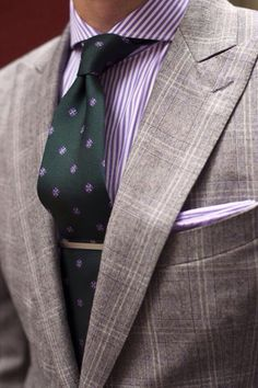 The tie bar and pocket square really add to this look