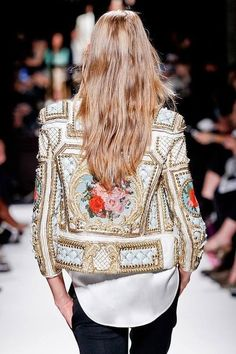 Balmain has been recently had a new creative director Oliver Rousting . With his modern Parisian creative direction . Fortunately , Balmain have been able to create the most beautifully pearl embellished gowns and ready to wear gourmets . Such as this stunning jacket and one Kim Kardashians wedding dress .
