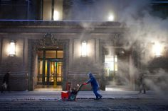 A worker pushes a snow blower down Lexington Avenue near Grand Central Terminal as it snows in the Manhattan borough of New York January 26, 2015. A swath of the U.S. East Coast from Philadelphia to New York City to Maine was bracing for a potentially historic blizzard on Monday with a winter storm that is expected to dump as much as 3 feet (90 cm) of snow and snarl transportation for tens of millions of people.