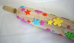 foam stickers on a rolling pin. Roll through paint to create awesome prints.: