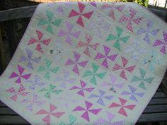Baby girl quilt, pinwheel posy. via Etsy.