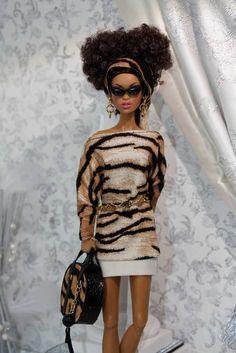 Cotton print dress w/gold belt, print bandana and print leather suitcase.