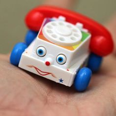 Nostalgia alert! Your favorite classic pull toy is now available in a fully functional, miniature edition! World's Smallest Fisher Price Chatter Phone is a pocket-sized toy that comes with the same friendly face as the 1960's original, and a ringing spin-dial!