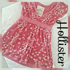 """HOLLISTER """"Spring fling in swing"""" peasant top Beautiful rosy pink swing top by Hollister in excellent condition minor wear. Very figure flattering with plunging v-neck and elastic band.   SAVE MORE NOW BY BUNDLING Hollister Tops"""