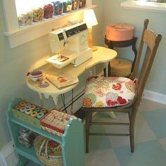 love this cute little sewing corner//// my sewing area is cuter...but I thought this was a sweet sewing picture!