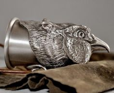 Stirrup cup made with silver-plated bronze, in the form of pheasant.