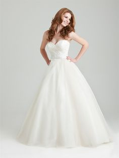 Style: 2566    A soft and romantic tulle ball gown. This design features an asymmetrically ruched strapless bodice with a sweetheart neckline and natural waistline defined with lace appliques.   Colors:	 White, Ivory, Ivory/Champagne  Fabric:	 Lace and Organza