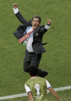 The World Cup so far, how are things going? Costa Rica's head coach Jorge Luis Pinto celebrates after winning the group D World Cup soccer match between Italy and Costa Rica at the Arena Pernambuco in Recife, Brazil, Friday, June 20, 2014. Costa Rica beat four-time champion Italy 1-0 to secure a spot in the next round. (AP Photo/Hassan Ammar)