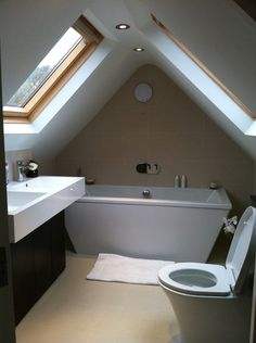 An attic can be the perfect space for an extra bath. Exposed beams and skylights can make this small attic bathroom a cool and relaxing retreat. No matter if your size attic is small and tiny, your bathroom will look… Continue Reading → Small Attic Bathroom, Attic Bedroom Small, Attic Loft, Loft Room, Attic Rooms, Attic Spaces, Bedroom Loft, Attic Office, Garage Attic