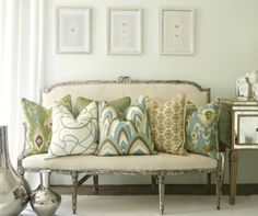 Like the idea of covering antique couch with large pillows, could so do this in the formal living room